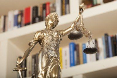 Statue of Justice, blindfolded and holding her scales and sword